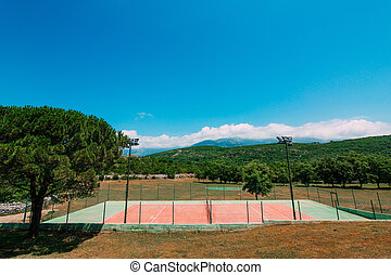The private tennis court at the villa by the sea, Montenegro, Ad