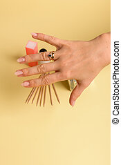 The procedure for removing varnish from nails hybrid nails in progress. Gel nail polish remover foils on woman's hands.