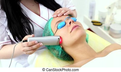 The procedure for treating cold laser. - Young and beautiful...