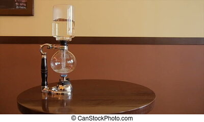 The process of brewing the brewed coffee through a filter in...