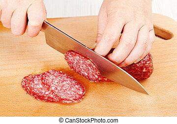 the process of cutting salami