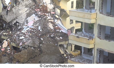 the process of destruction of the old building with heavy...