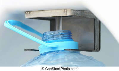 The process of filling drinking water. Close-up - The...