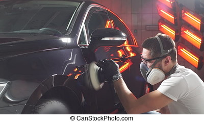 The process of polishing car body - Master polishes the car...