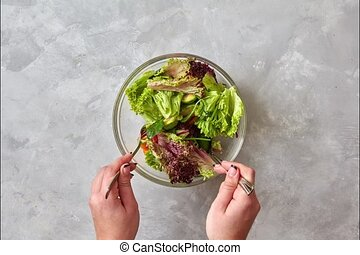 The process of preparing a healthy vegetarian salad from...