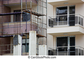 The process of renovating a new building. New construction, exterior wall insulation