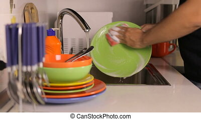 The process of washing dishes in the sink