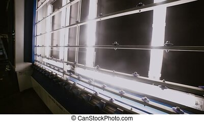 The production line for the manufacture of glass for PVC windows.