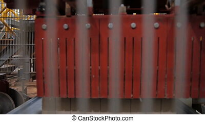 The production of bricks - Brick factory. The mechanical...