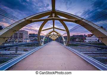 The Puente de Luz Pedestrian Bridge at sunset, in Toronto, Ontario.