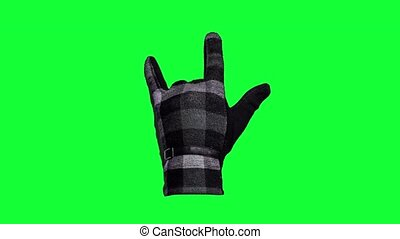 The punk rocker hand sign on green screen