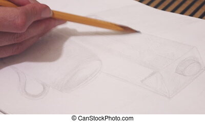the pupil draws a sketch of a cylindrical subject a pencil