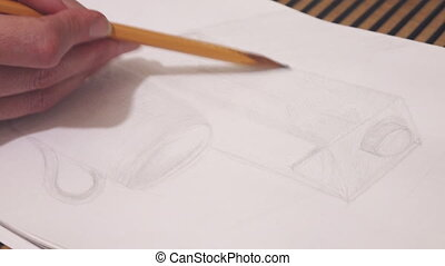 the pupil draws a sketch of a cylindrical subject a pencil.