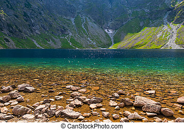 the purest mountain lake Czarny Staw on a sunny day in the Tatras, Poland