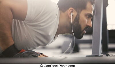 The Pushup Workout - Closeup of bearded man in white t-shirt...