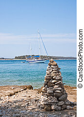 The pyramid of stones on a background of the sea. Croatia