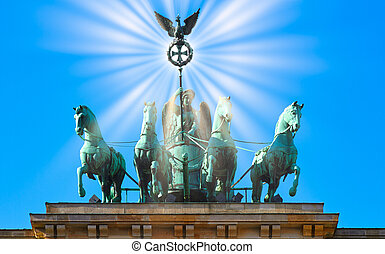 The Quadriga stands on the Brandenburg Gate in Berlin.