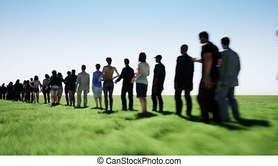 The queue of people on the background of a field of grass