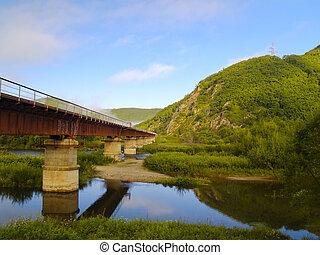 The railway bridge at a mountain slope