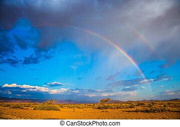 The rainbow crosses the sky