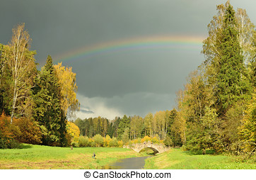 The rainbow in the sky after the rain.