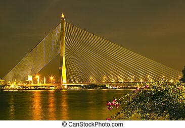 The Rama eight bridge at night in Bangkok
