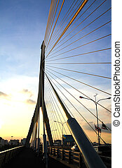 The Rama VIII bridge over the Chao Praya river at sunset in Bangkok, Thailand