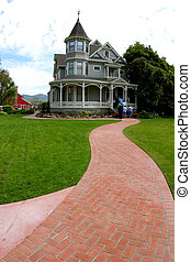 The Red Brick Road - A red-brick sidewalk leads up to a...