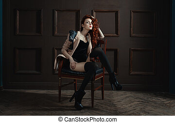 The red-haired girl posing on a chair. - The red-haired girl...