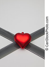 The red heart and the unrolled exposed 35mm film strips