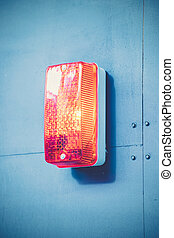 The red light on blue wall