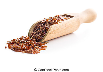 The red rice in wooden scoop.