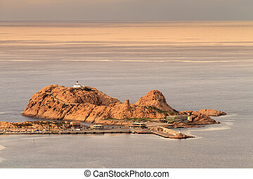 The red rock at Ile Rousse in Corsica - The red rock and...