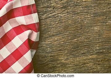 red tablecloth over old wooden table