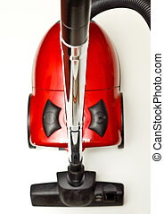 The red vacuum cleaner with a black hose on a white background