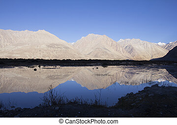 The reflection of mountain at Nubra valley