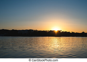 The reflection of the sunset in the lake. Background for design.