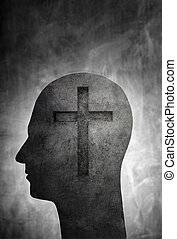 Conceptual image of a head with a christian cross symbol.