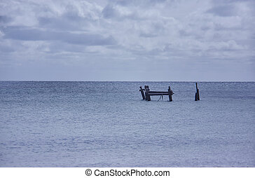 The remains of the pier in the middle of the sea