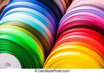 The various colors ribbon bobbins close up
