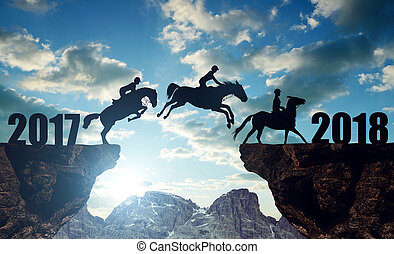 The riders on the horses jumping into the New Year 2018 at...