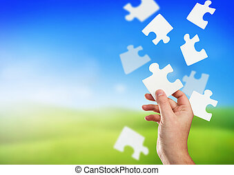 A man holding the correct piece of the puzzle.
