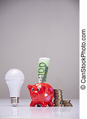 the right thing - piggy bank and savings going from the use...