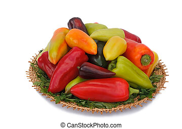 The ripe fruits of pepper red, yellow and green colors on ?????.???????????? on a white background.