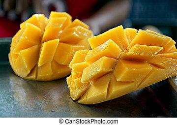 Ripe mangoes slices.