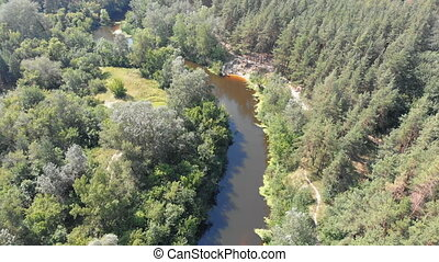 The river bed is a top view from the drone. The quadrocopter...