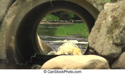 The river flows through a pipe.