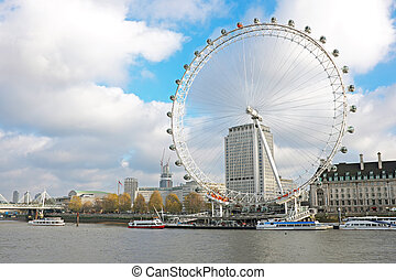 The river Thames with the London Eye in London UK