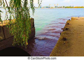 The riverscape of large drainage steel pipe background. concept of industrial wastes and environmental pollution