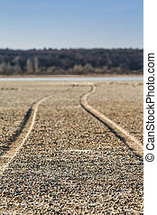 The road along the bottom of the dried lake, shallower depth of
